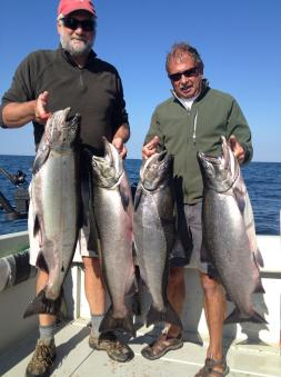 Salmon fishing on the easter basin of lake ontario on a charter boat