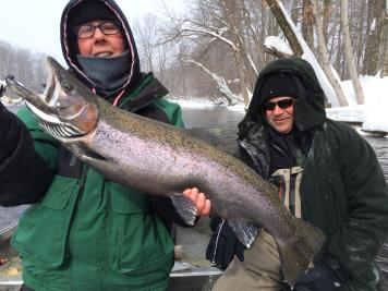 Heated Drift boat fishing down the Salmon River in Pulaski Ny for steelhead trout
